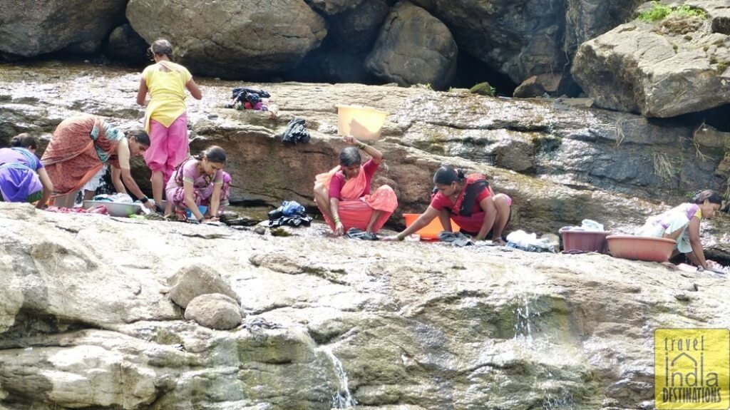 Local Women Washing Clothes at Nearby Streams